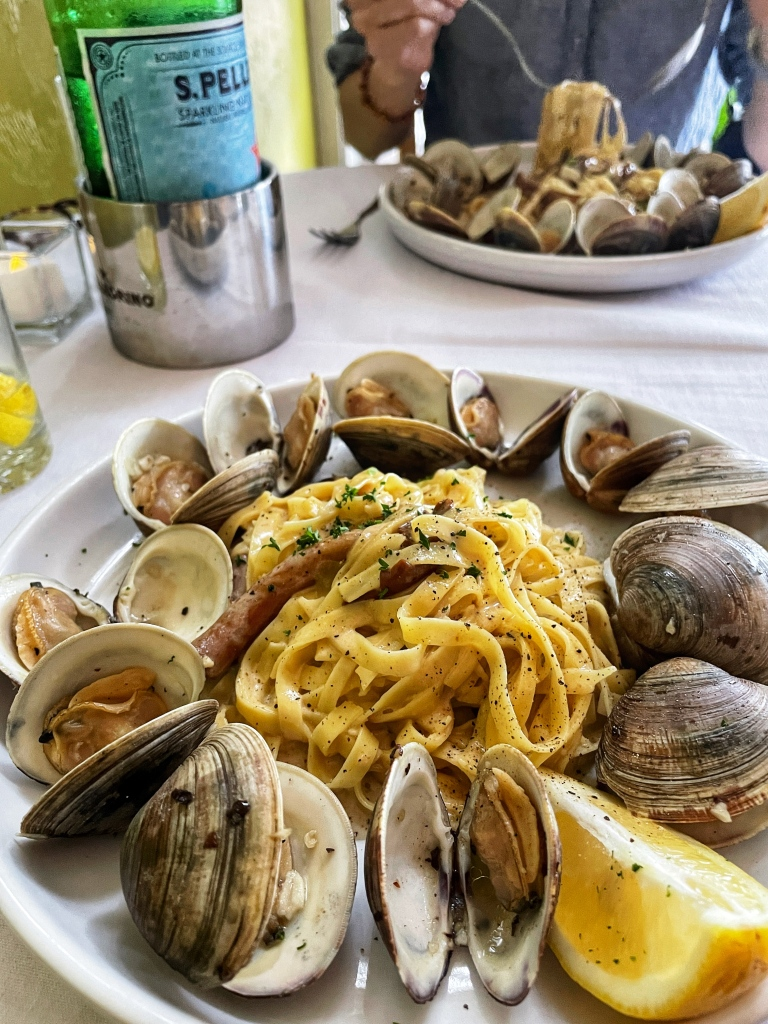 Fettuccini with clams, mushrooms, and white wine sauce