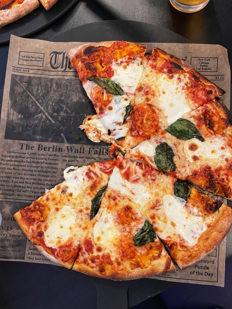 Loved this newspaper lining for the pizza!