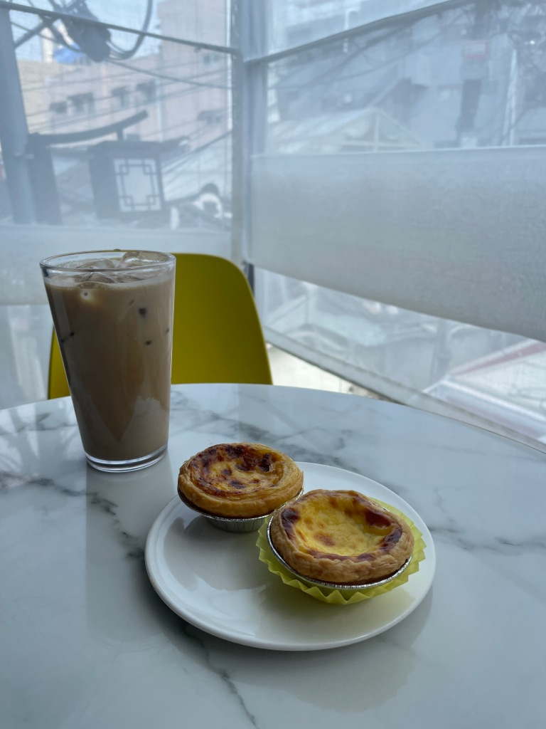 Iced coffee, Macau Egg Tart (upper left), Durian Egg Tart (bottom right)