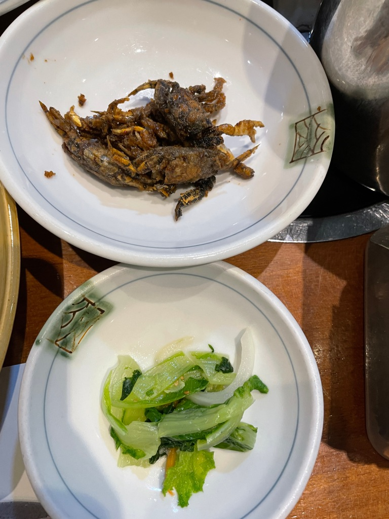 Side dishes: fried crabs (top), marinated cabbage (bottom)